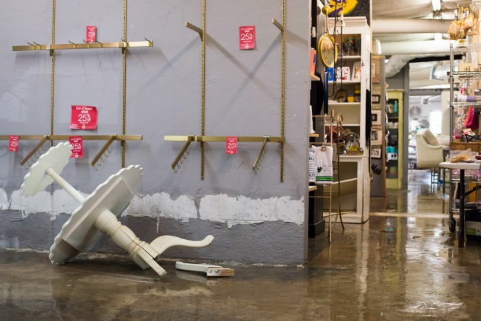 flooded business owners realizing business interruption insurance